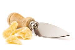 Queso y cuchillo de parmesano Imágenes de archivo libres de regalías