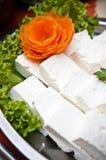 Queso y ensalada blancos Foto de archivo libre de regalías