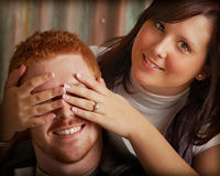 Quess who. Young couple in studio playful Royalty Free Stock Photo