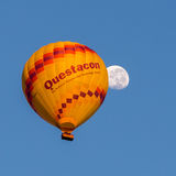 Questacon Hot Air Balloon and Moon. The Questacon Hot Air Balloon floats in front of the moon during Canberra's Balloon Spectacular festival 2015 Stock Images