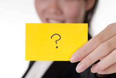Question. Symbol on business card holding by Asian businesswoman Royalty Free Stock Photos