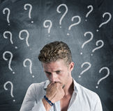 Question. A boy full of question Royalty Free Stock Photography