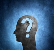 The Question. Human head cardboard silhouette with torn holes shaped like a question mark Stock Image