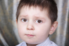 Question. Little boy with question in eyes expression Royalty Free Stock Images