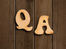 Question and answer. Question and answer letters over wooden table stock photos