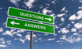 Question and Answer Signs. Against a blue sky royalty free stock image