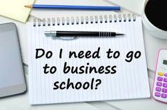Question Do I need to go to business school. On notebook Royalty Free Stock Photo