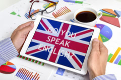 Question do you speak English? in a tablet Stock Photo