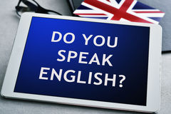 Question do you speak English? in a tablet computer Stock Photo