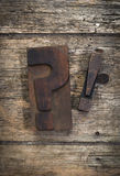 Question and exclamation marks vintage letterpress printing bloc. Ks on rustic wood background Royalty Free Stock Photography