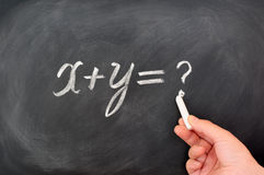 Question formula written on blackboard Stock Image