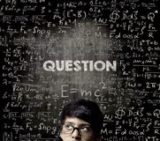 Question. Half Face Genius Boy Thinking Wearing Glasses Chalkboa Stock Photography