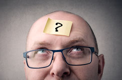 Question. Head portrait with a posits with question mark Royalty Free Stock Photo