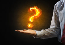 Question light sign. Close of businessman hand showing burning fire sign Stock Photo