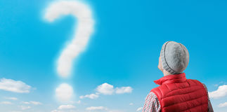 A question. Question made of clouds and man Stock Photo