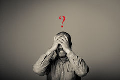 Question. Man in thoughts. Drama. Man in thoughts. Expressions, feelings and moods Royalty Free Stock Images