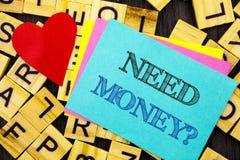 Question manuscrite d'argent du besoin d'apparence des textes La crise économique de finances de photo conceptuelle, prêt en espè Photo libre de droits