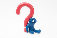 Question mark. Plasticine person with a red Question Mark Royalty Free Stock Photo