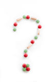 Question mark. Made of red, green and orange pills on the white background Royalty Free Stock Images