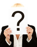 Question mark. Closeup of a businesswoman holding question mark on white background Stock Photo