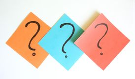 Question mark. Three question marks on papers stock image