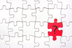 Question mark. Red gap left by missing piece from jigsaw puzzle with a question mark Stock Photos