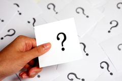 Question mark. Hand holding paper card with question mark Royalty Free Stock Image