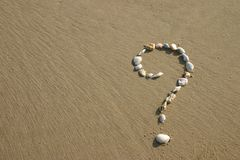 Question mark. Seashells in the shape of a Question mark Stock Image