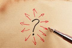 Question mark. And group of arrows drawn on paper using a pen Royalty Free Stock Images