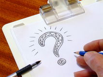 Question Mark. An elaborate question mark that has been doodled on a clipboard Royalty Free Stock Photo