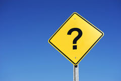 Question mark against blue sky. Question mark on warning sign against blue sky Stock Photo