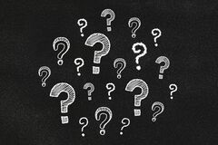 Question mark on a black chalkboard. Textured background.