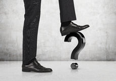 Question mark. Businessman comes foot on a question mark Stock Photo
