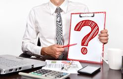 Question mark. Businessman holaing clipboard with drawing question mark Royalty Free Stock Photos