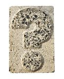 Question mark carved in a concrete block Stock Images