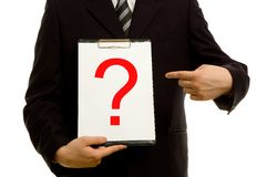 Question mark on clipboard. In the hand of a businessman Royalty Free Stock Photos