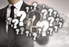 Question mark cloud is shown by businessman concept royalty free stock photography