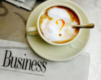 Question mark coffee and newspaper Royalty Free Stock Photo