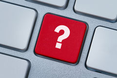 Question mark at the computer key Royalty Free Stock Photography