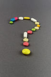 Question mark created from colored pills. Medical concept Royalty Free Stock Photos