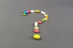 Question mark created from colored pills. Medical concept Royalty Free Stock Image