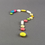 Question mark created from colored pills. Medical concept Stock Image