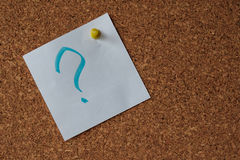 The question mark on the detachable piece of paper. Attached to a Board made of cork Stock Photography