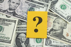 Question mark on dollar banknotes Stock Photography