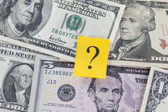 Question mark on Dollar Bills Stock Photography