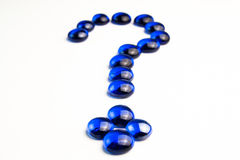 Question mark drawn with blue stones Royalty Free Stock Image