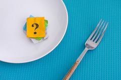 Question mark on an empty white plate with fork stock photos