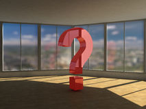 Question mark in empy room. A view of a large, red question mark in a large, empty office with many windows royalty free stock photo