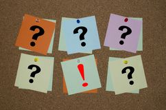 Question mark and exclamation mark on paper notes Royalty Free Stock Photos