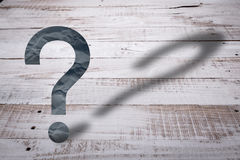 Question mark float on white rustic wooden floor Stock Photography